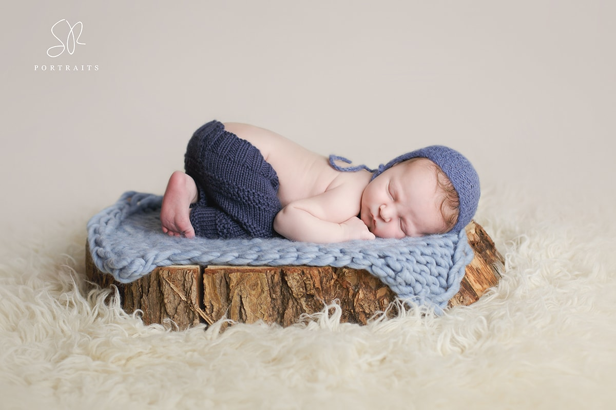 Baby on log, Newborn Photography Leicestershire