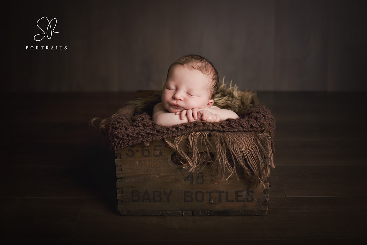 Baby in Crate, Newborn Photography Leicestershire
