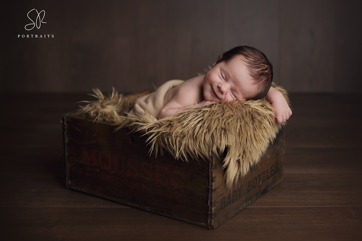 Baby smiling in crate Newborn photography Coalville, SR Portraits