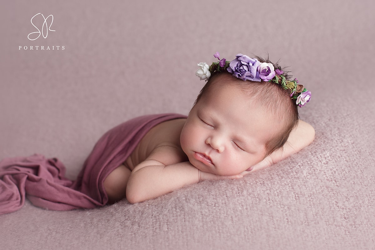 newborn baby on purple background photography coalville SR Portraits leicestershire