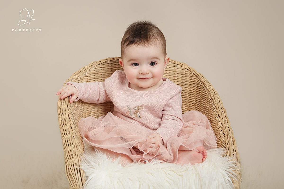 Baby Photos Leicestershire, sitting up 8 month old baby on wood background