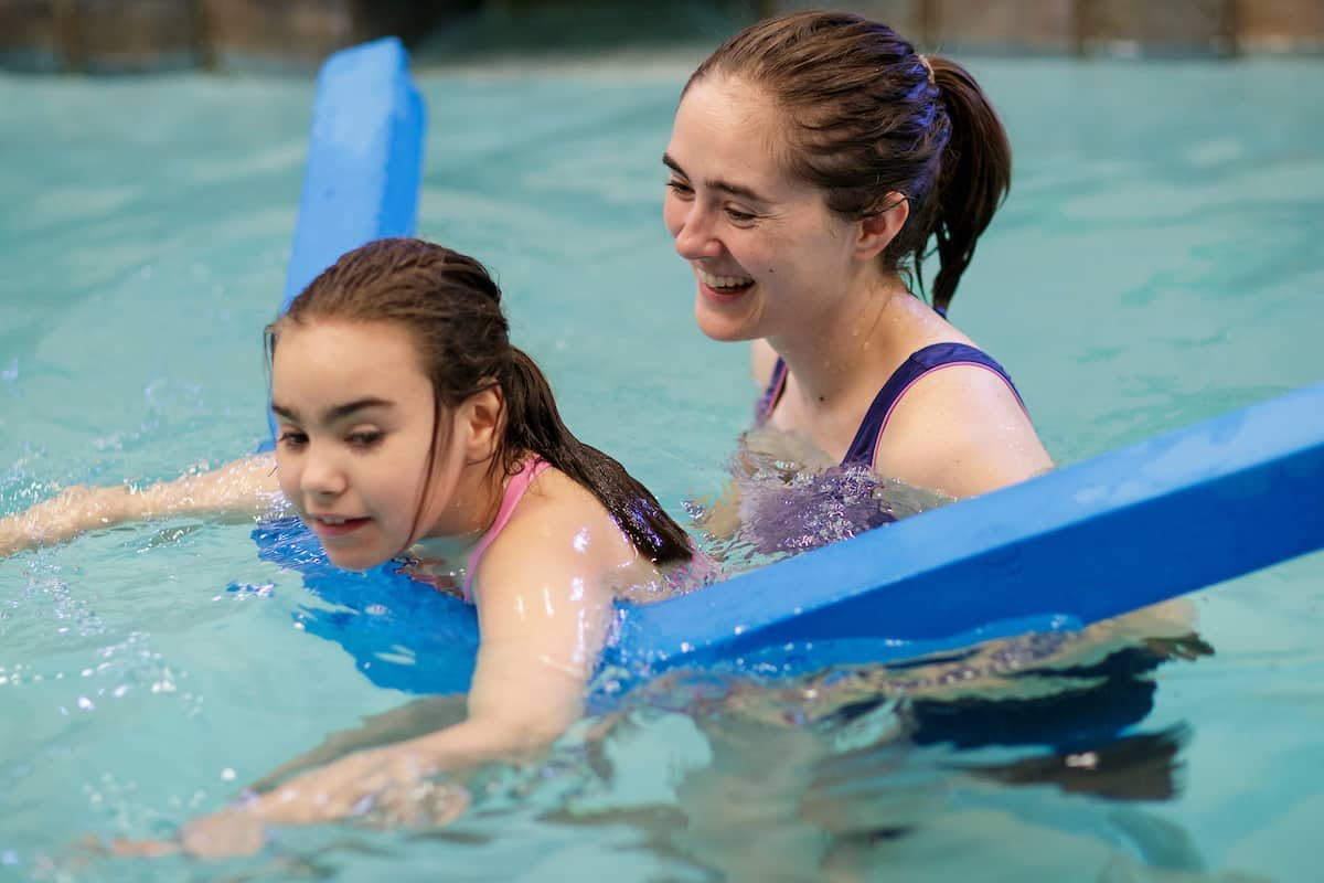 Emily Moss, BU '16, occupational therapist at Walker Therapy, works with a client in an aquatic therapy session. (AJ Reynolds/Brenau University)