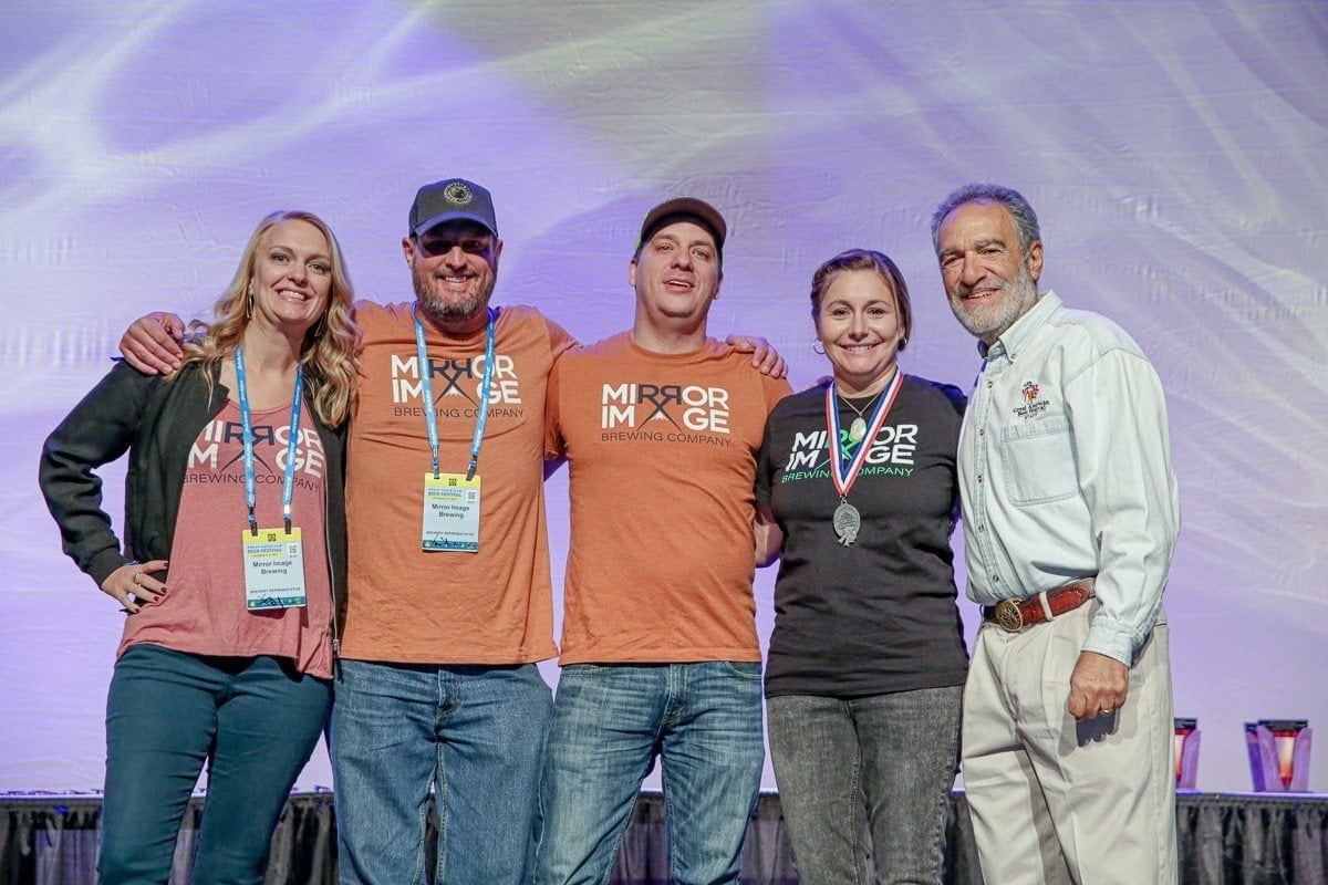 Mirror Image Brewing Company accepts their first GABF award at the Great American Beer Festival (GABF) 2019