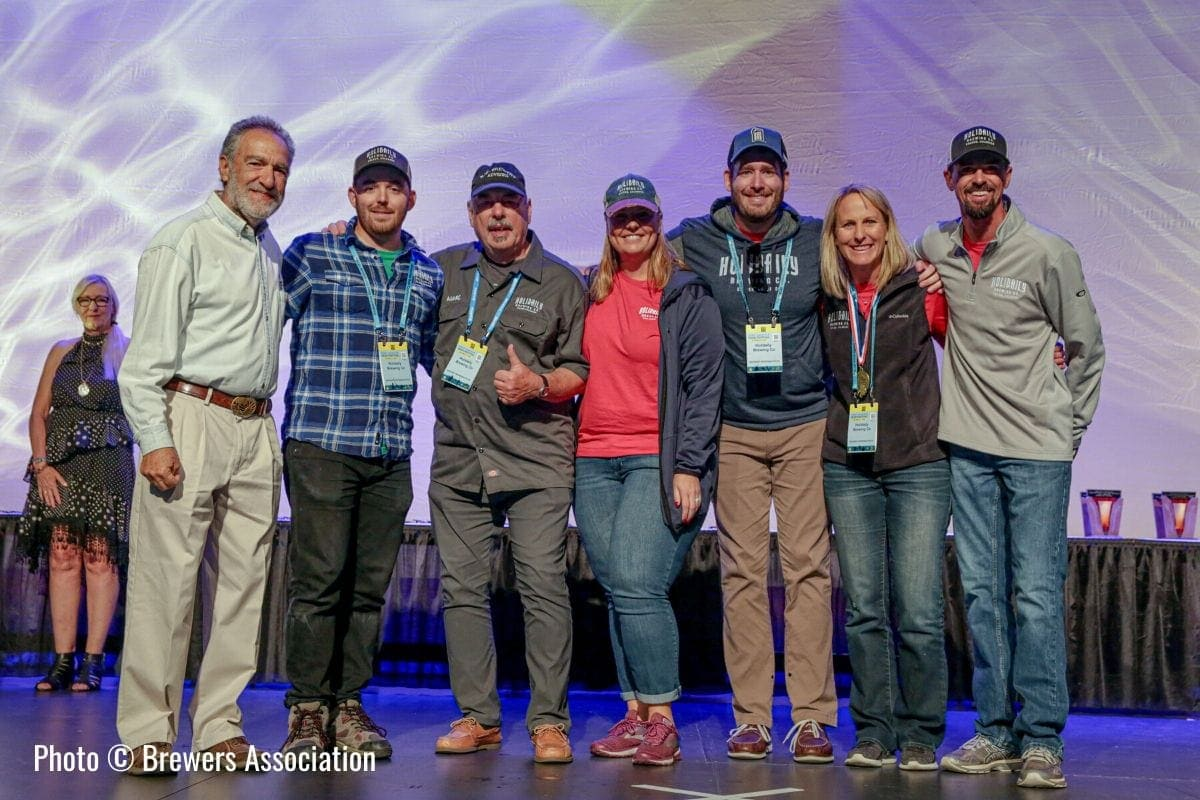 Holidaily Brewing Co accepting a gold medal at the Great American Beer Festival in 2019. Photo from the Brewer's Association.