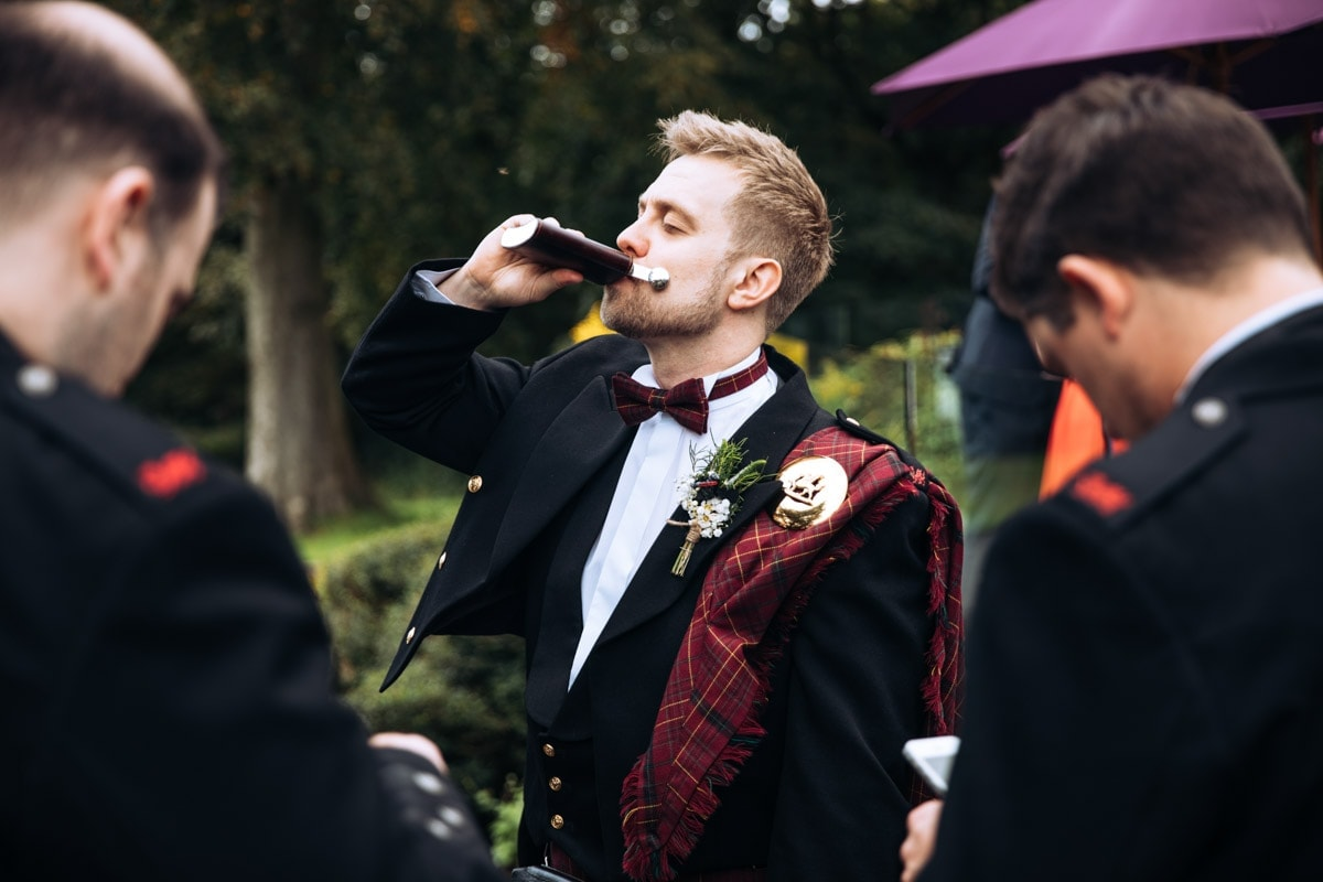 groom and his hit flask