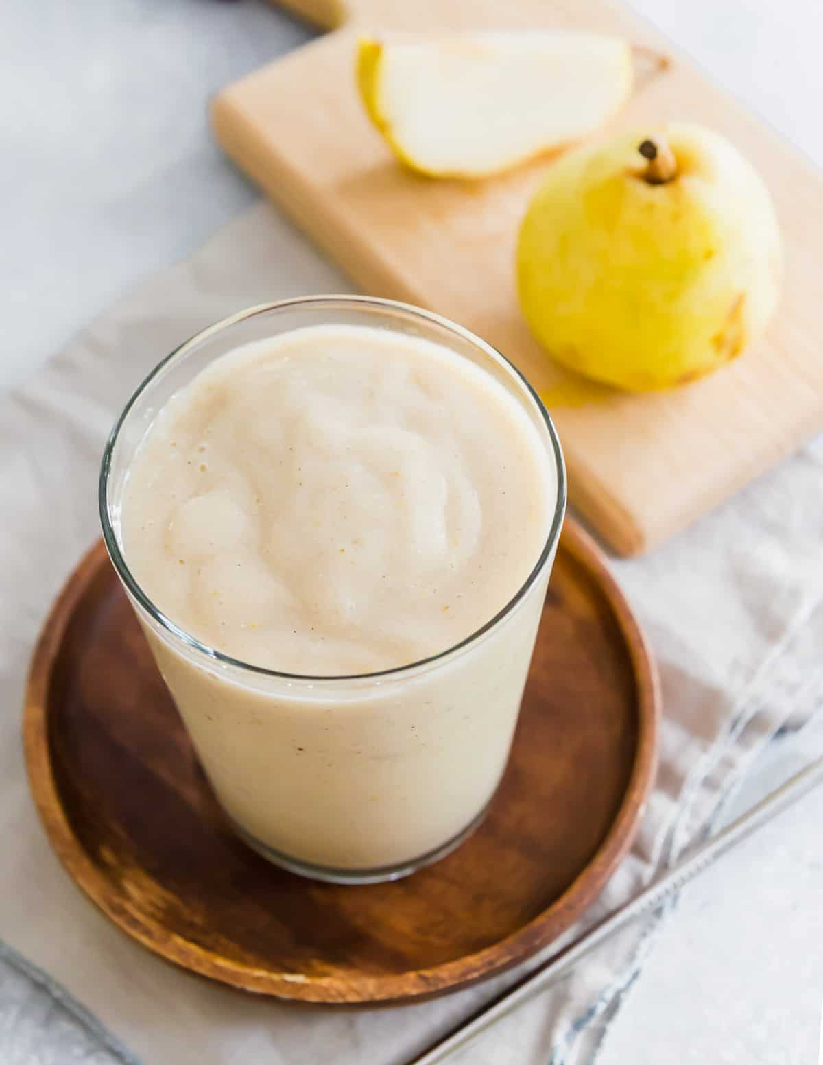This easy pear smoothie is flavored with banana and cinnamon. It's a healthy, high protein snack or breakfast you can make in minutes with just a handful of ingredients.