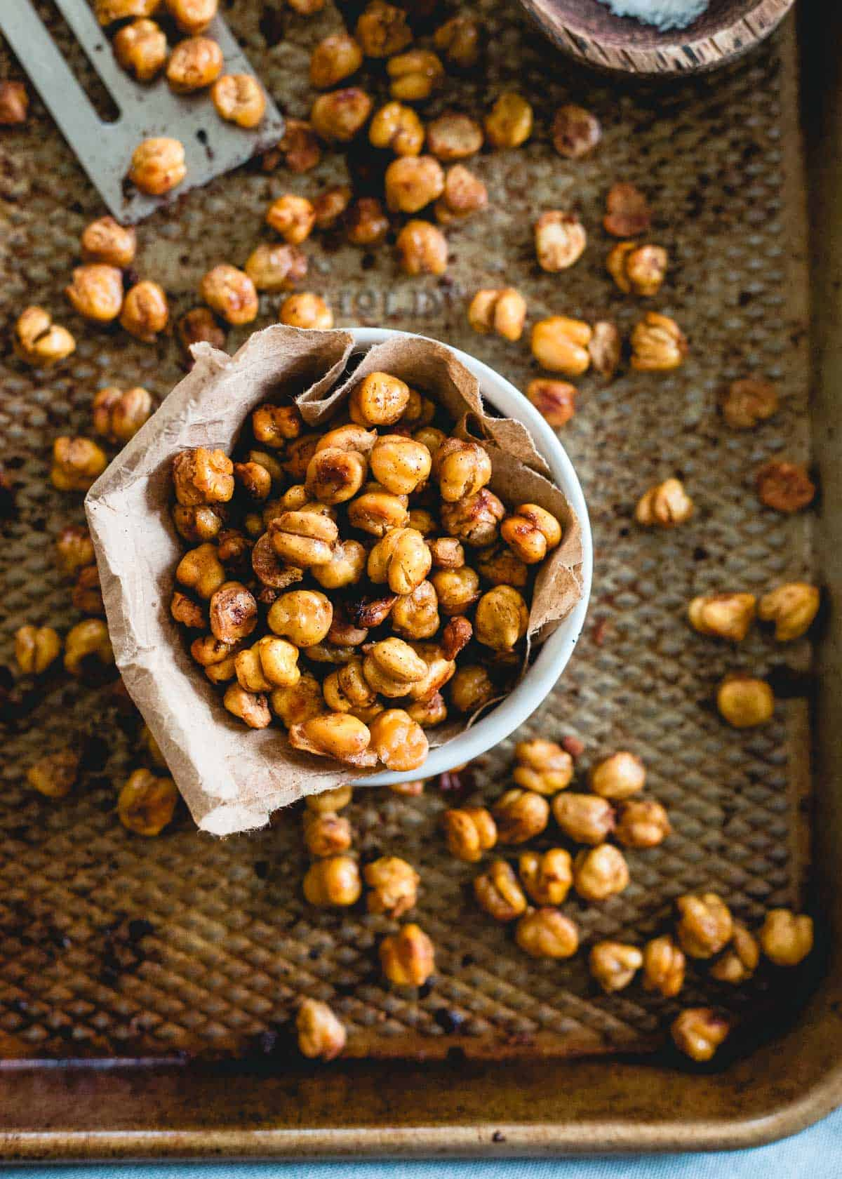 These cinnamon toast crunch roasted chickpeas taste just like the cereal. Made with maple syrup, coconut oil and cinnamon, they're a much healthier way to snack.