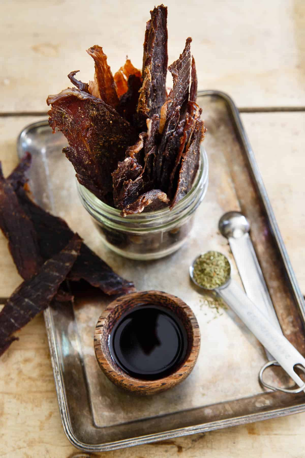 Lamb Jerky seasoned with oregano, garlic, onion, worcestershire and soy sauce is a healthy, high protein snack to keep on hand while out and about.