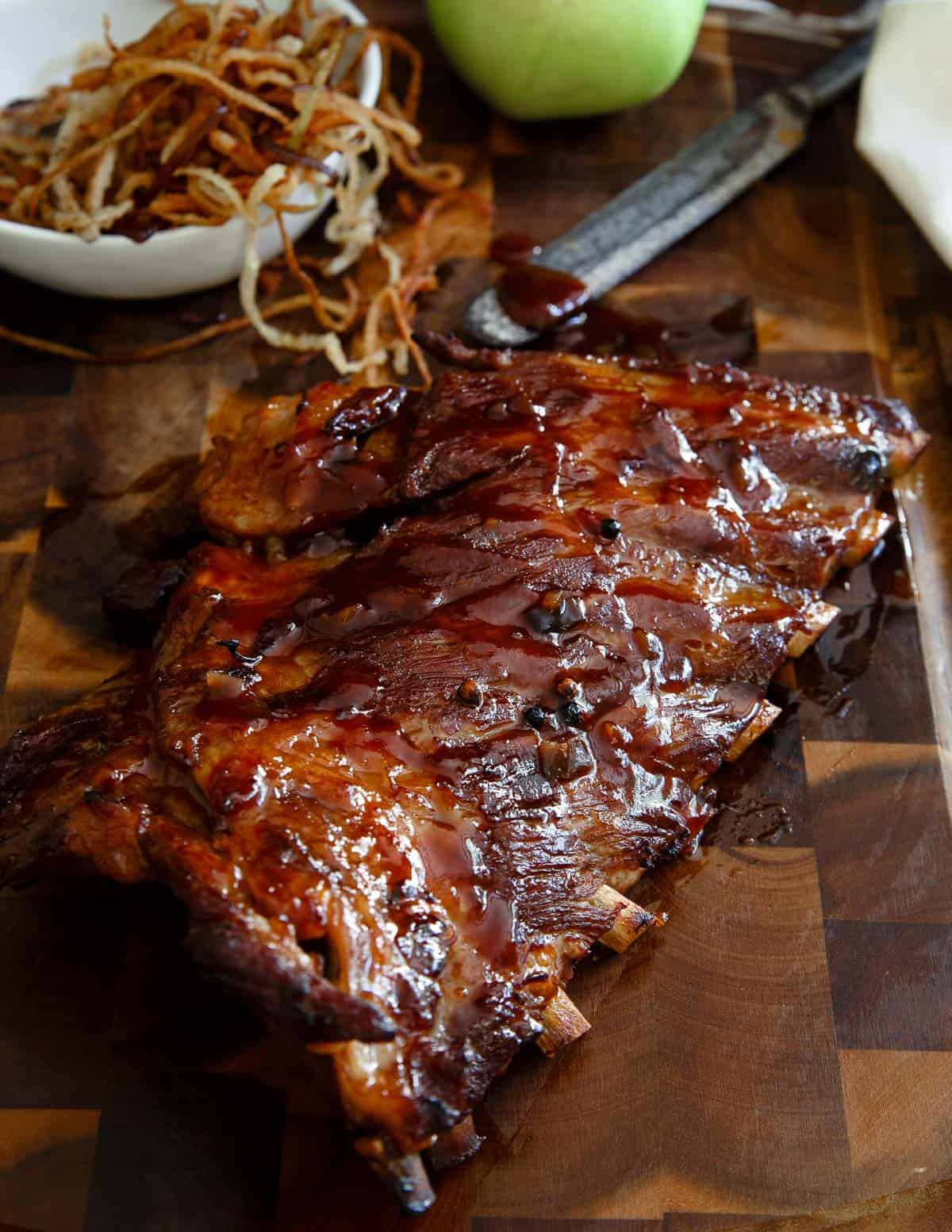 These sticky maple apple ribs are simmered in a maple syrup and apple juice broth then glazed and baked to sticky perfection!