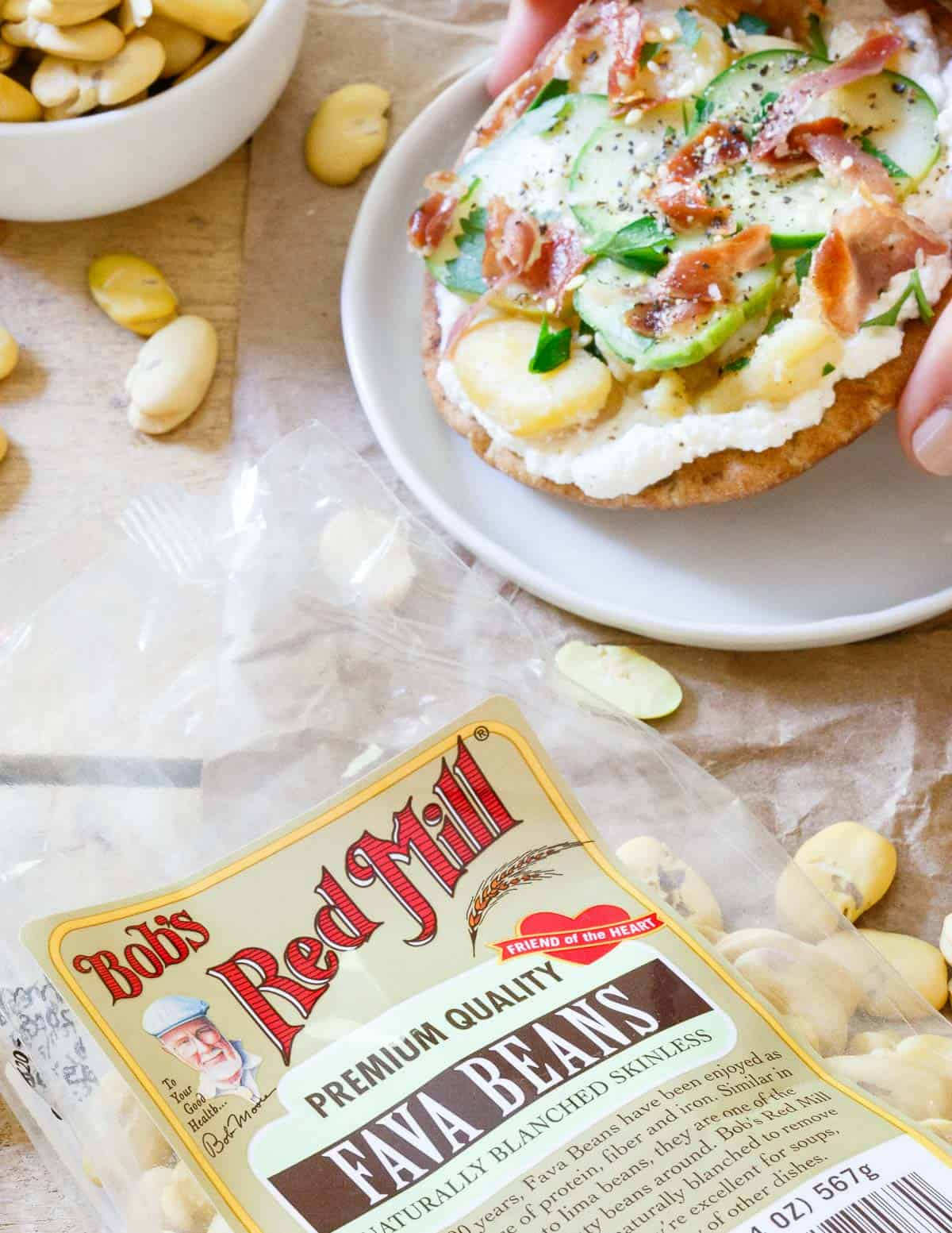 Creamy ricotta, buttery smashed fava beans, tangy cucumbers and salty prosciutto make these fava bean grilled pita bites an amazing light lunch or appetizer.