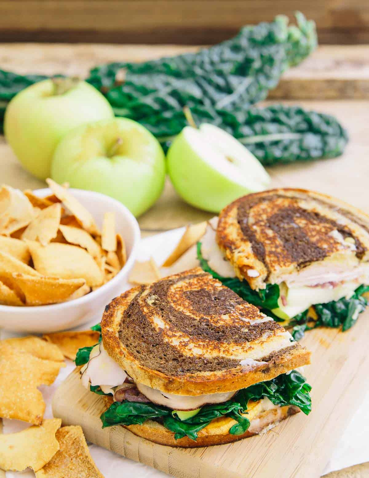 This roasted sweet potato apple ham sandwich is served hot and pressed with a generous amount of melted cheddar cheese and a honey mustard spread. There's a ton going on and you'll love every bite!