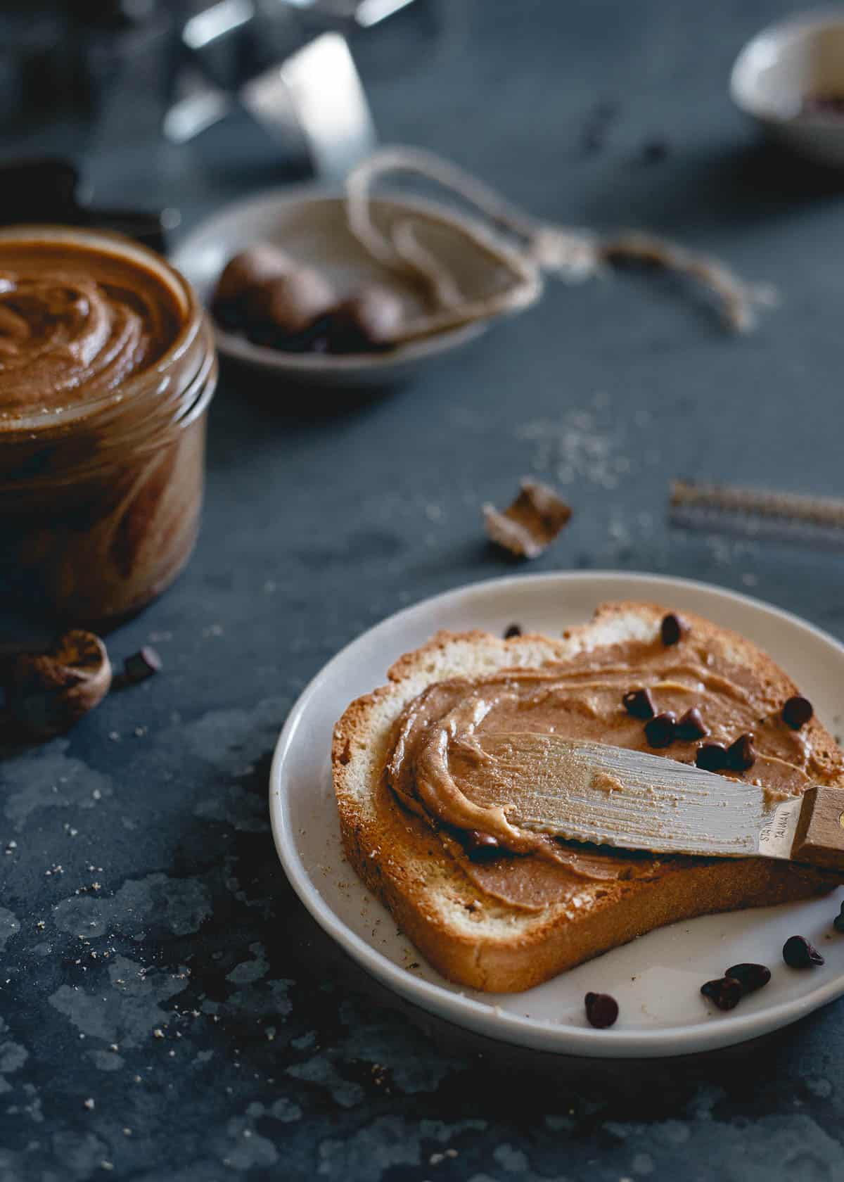 This creamy gingerbread peanut butter is made with molasses roasted peanuts, holiday spices and optional chocolate chips. Enjoy it this holiday season on toast, dolloped in oatmeal or straight from the jar with a spoon!