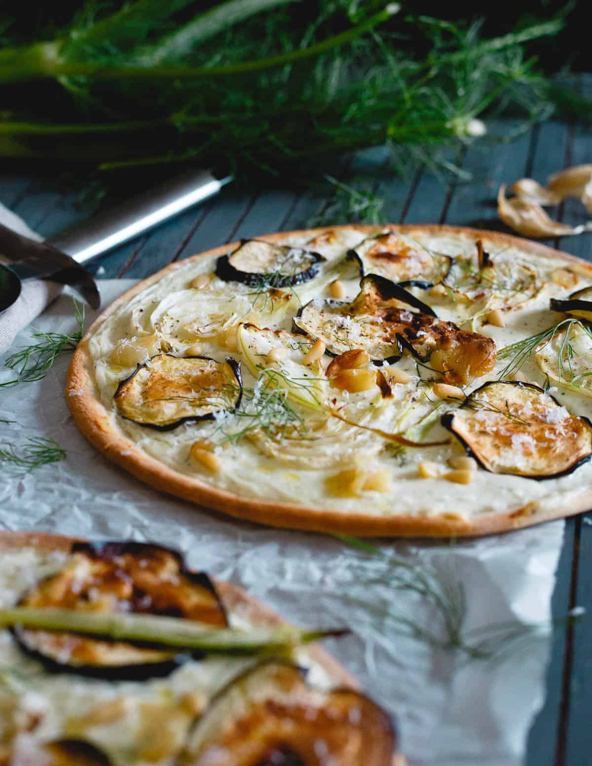 With a premade gluten-free crust, this roasted eggplant fennel pizza is an easy weeknight meal!