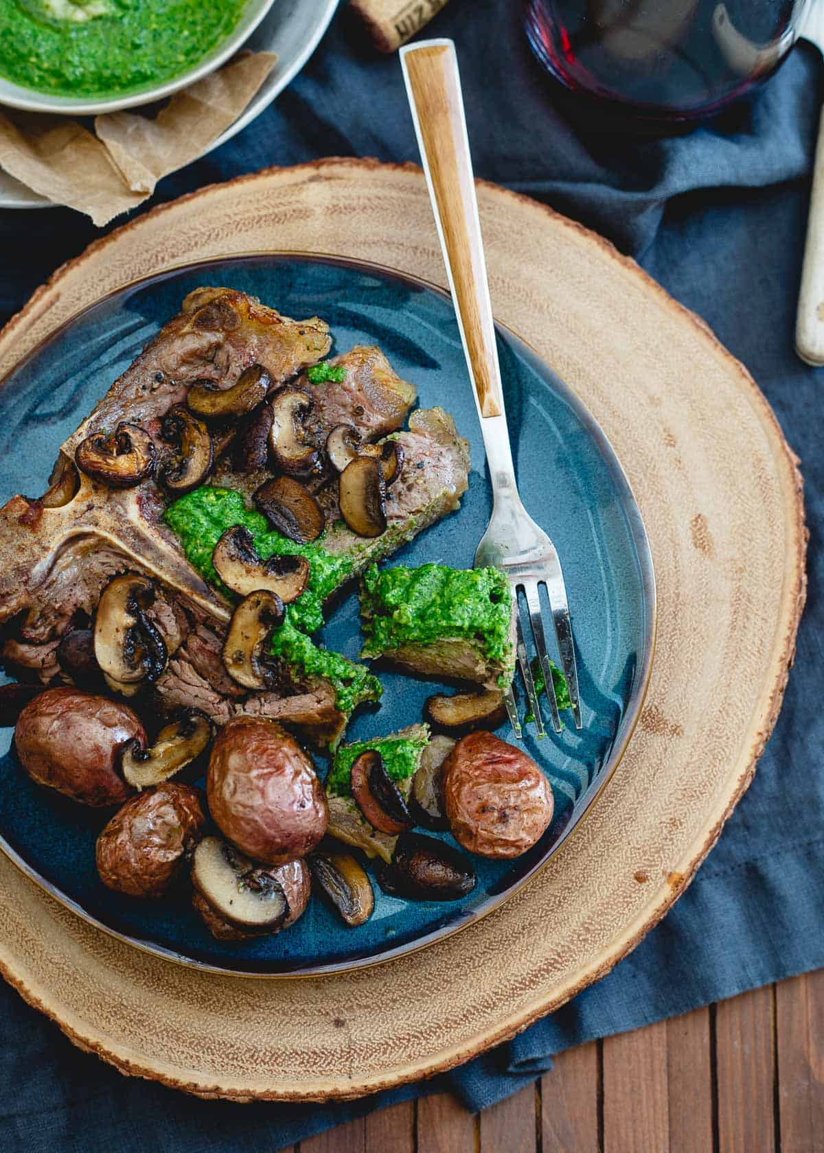 This porterhouse steak skillet has roasted baby red potatoes and mushrooms all made in the same pan for an easy, impressive dinner.