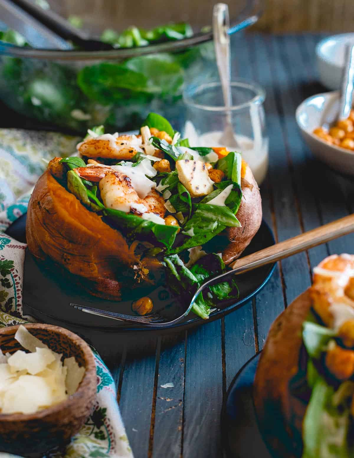 Caesar salad stuffed sweet potatoes with shrimp and chickpeas are perfect for a healthy meal not shy on flavor!