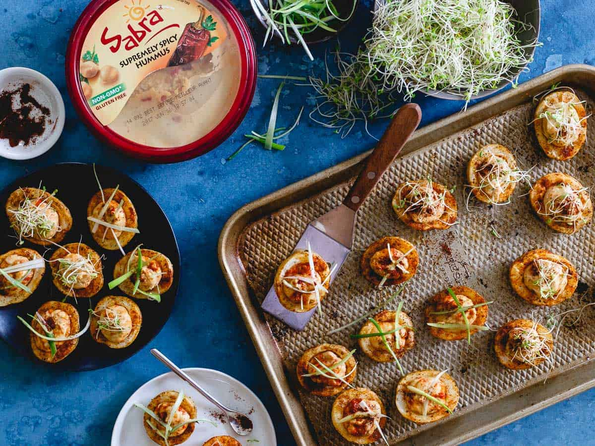 Sabra's supremely spicy hummus is stuffed into spice rubbed mini roasted potatoes. A fun appetizer with a kick!