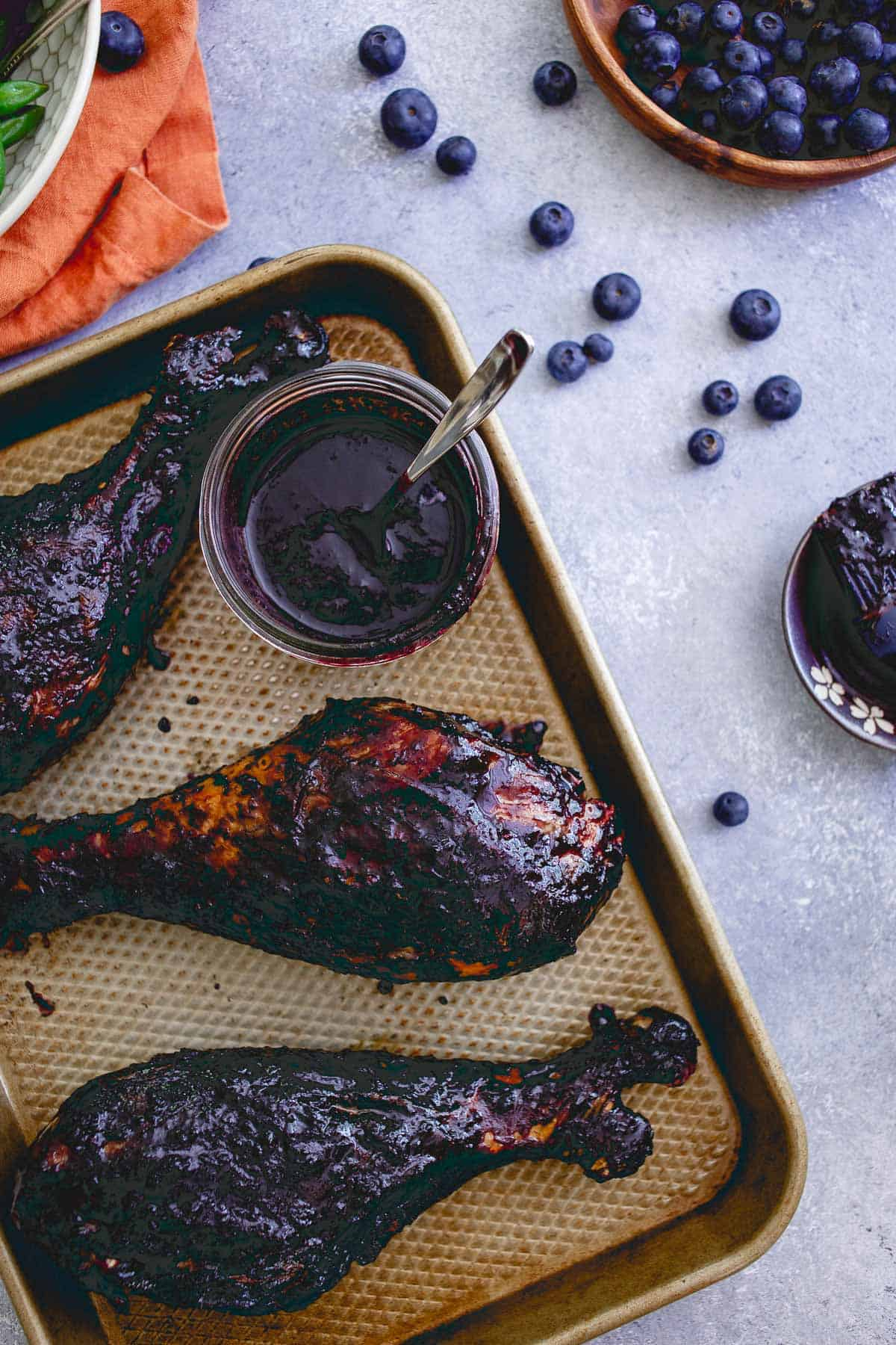 Easy, healthy and with an ingredient list you'll be happy to feed your family, these blueberry balsamic BBQ turkey legs are a great summer meal!