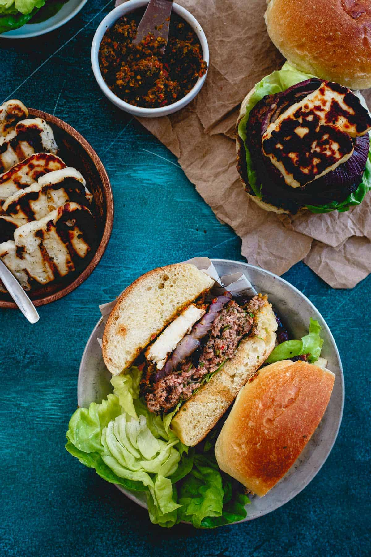 These lamb burgers are packed with fresh herbs, grilled red onions, a Mediterranean sun-dried tomato pesto spread for a nice change of pace to your summer burger.