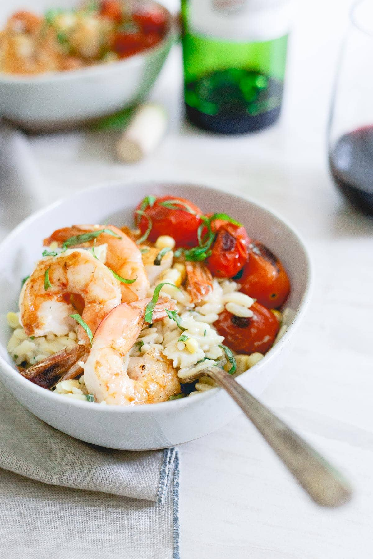 This elegant summer meal of brown butter shrimp with creamy parmesan orzo is perfect for a date night in.