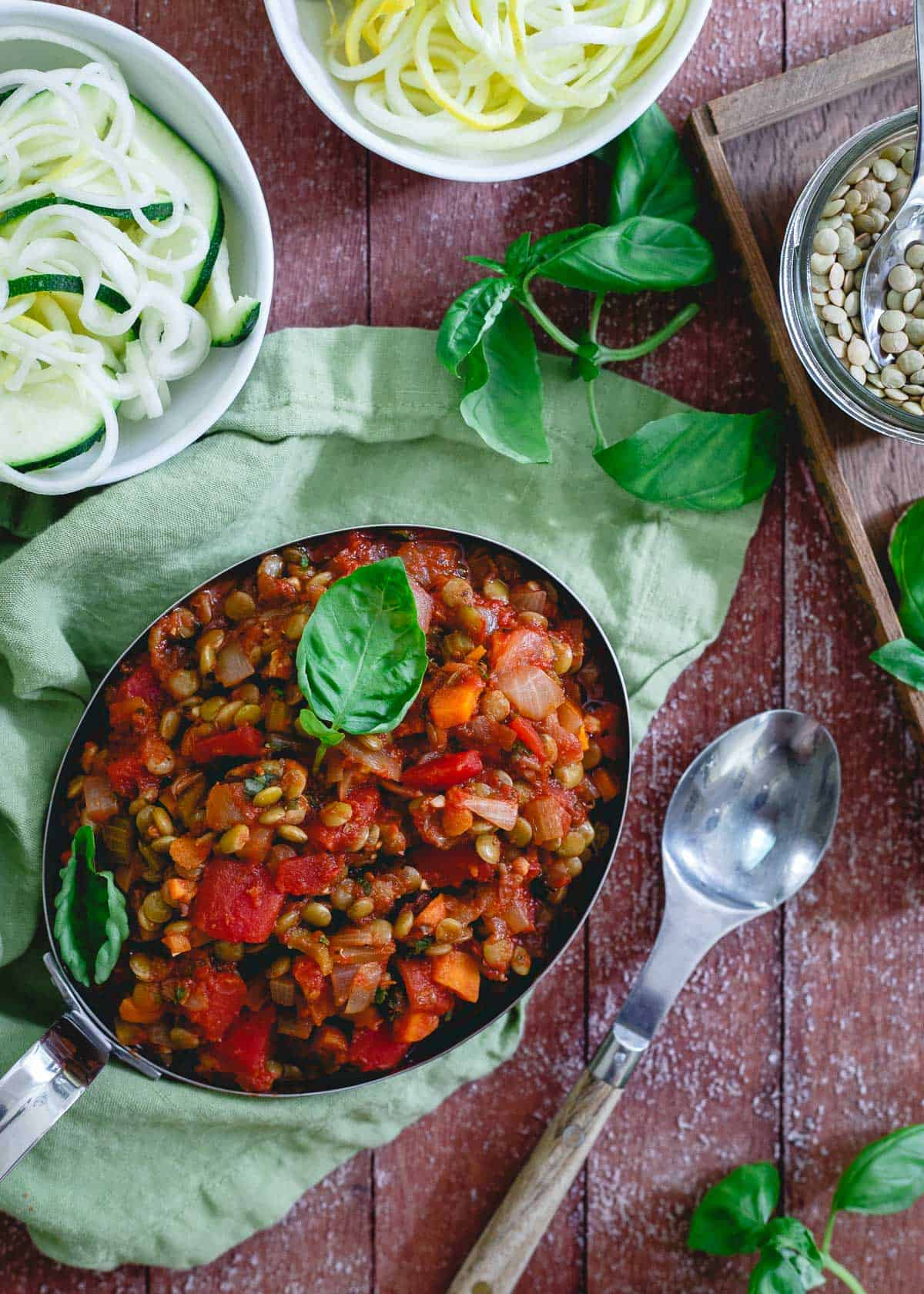 Lentil bolognese is a thick and hearty vegetarian pasta sauce option. Also delicious over summer squash noodles, polenta or your favorite grain.