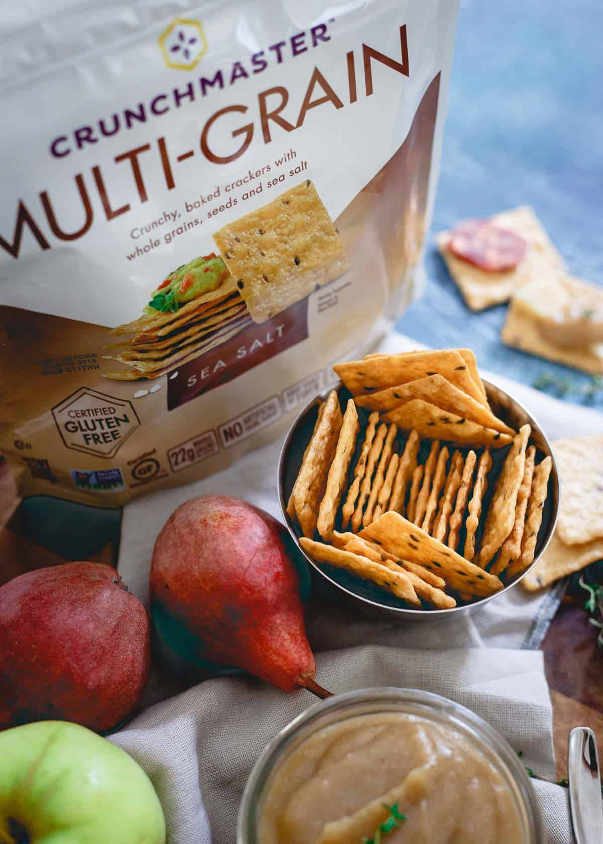 Crunchmaster gluten-free crackers pair perfectly with pear apple butter for a delicious fall snack.