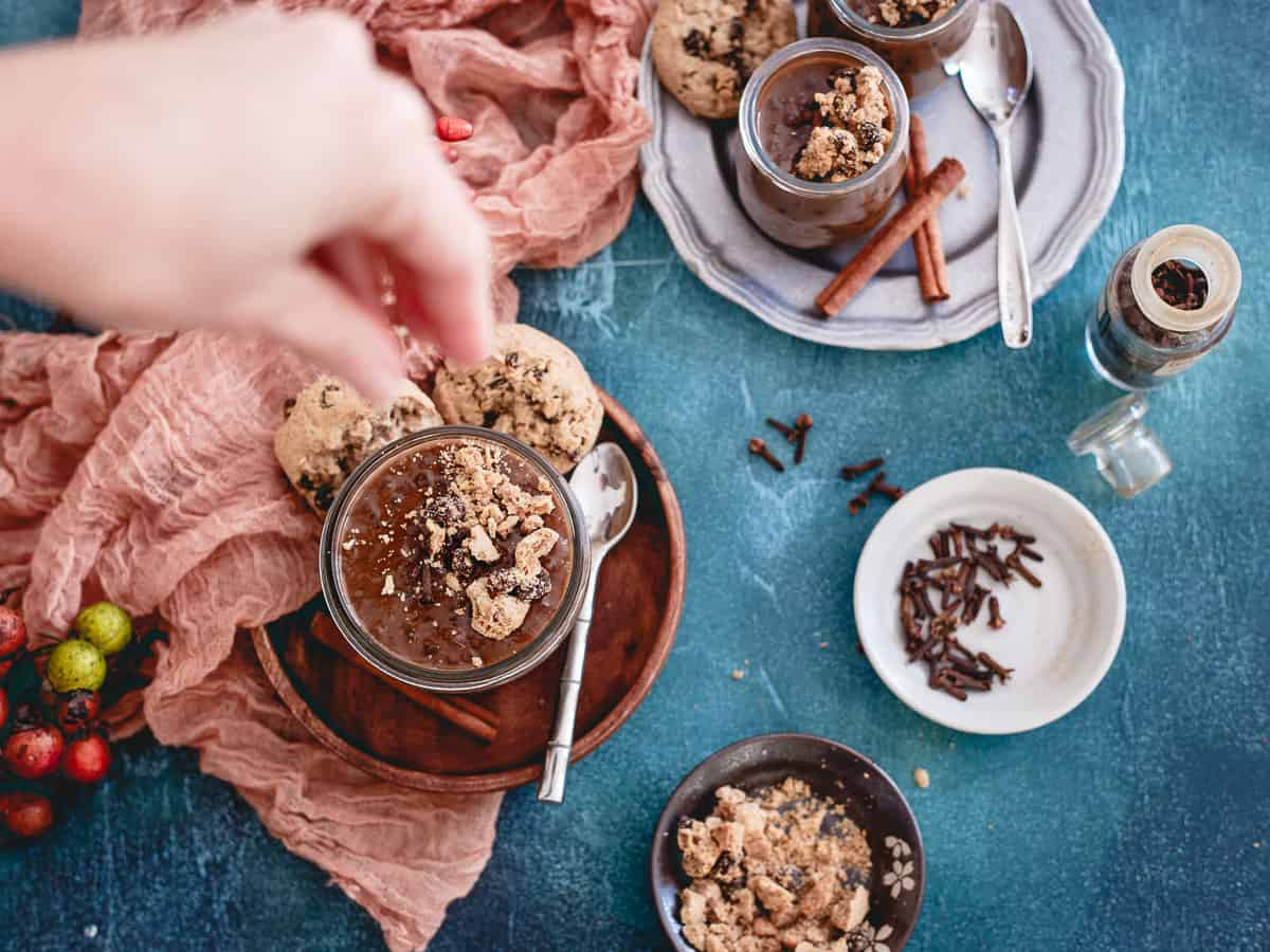 Adding oatmeal raisin cookie crumbles to the top of this dirty chai tapioca pudding makes it even more of a decadent dessert!