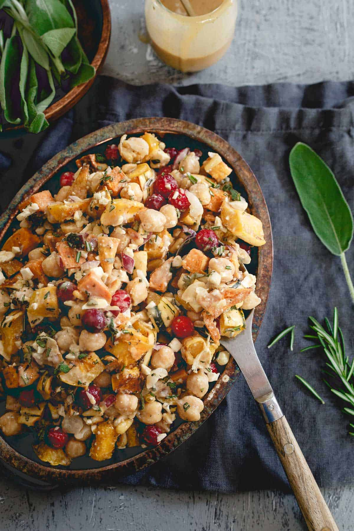 This salad has it all - roasted sweet potatoes, squash, chickpeas, cranberries, feta and a maple tahini dressing for a hearty fall dish packed with flavor.