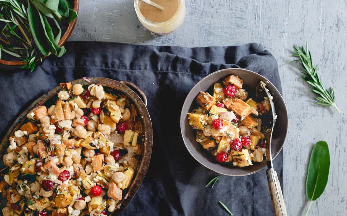 Celebrate fall in a hearty, vegetarian way with this roasted sweet potato, squash and chickpea salad.