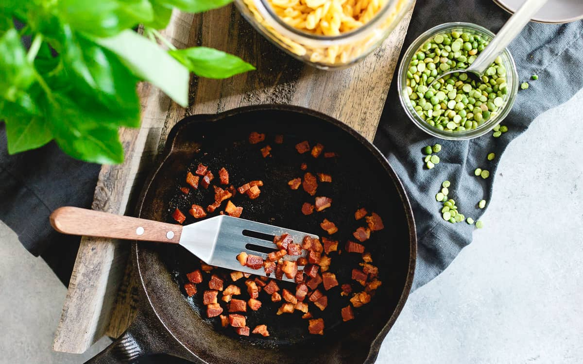 Crispy pan-fried pancetta is the perfect salty addition to this creamy split pea pesto pasta.