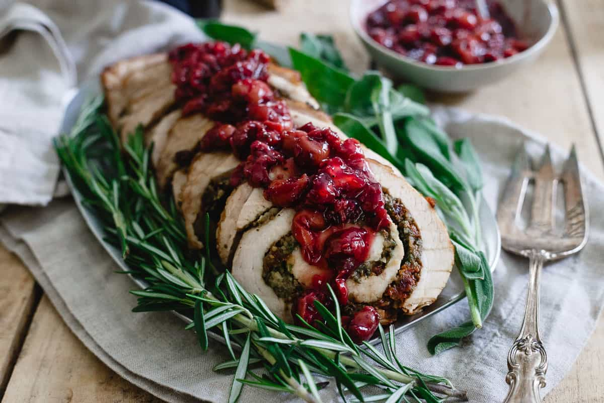 Try this gorgeous tart cherry chestnut stuffed turkey roulade topped with red wine soaked cherries for your winter holiday spread.