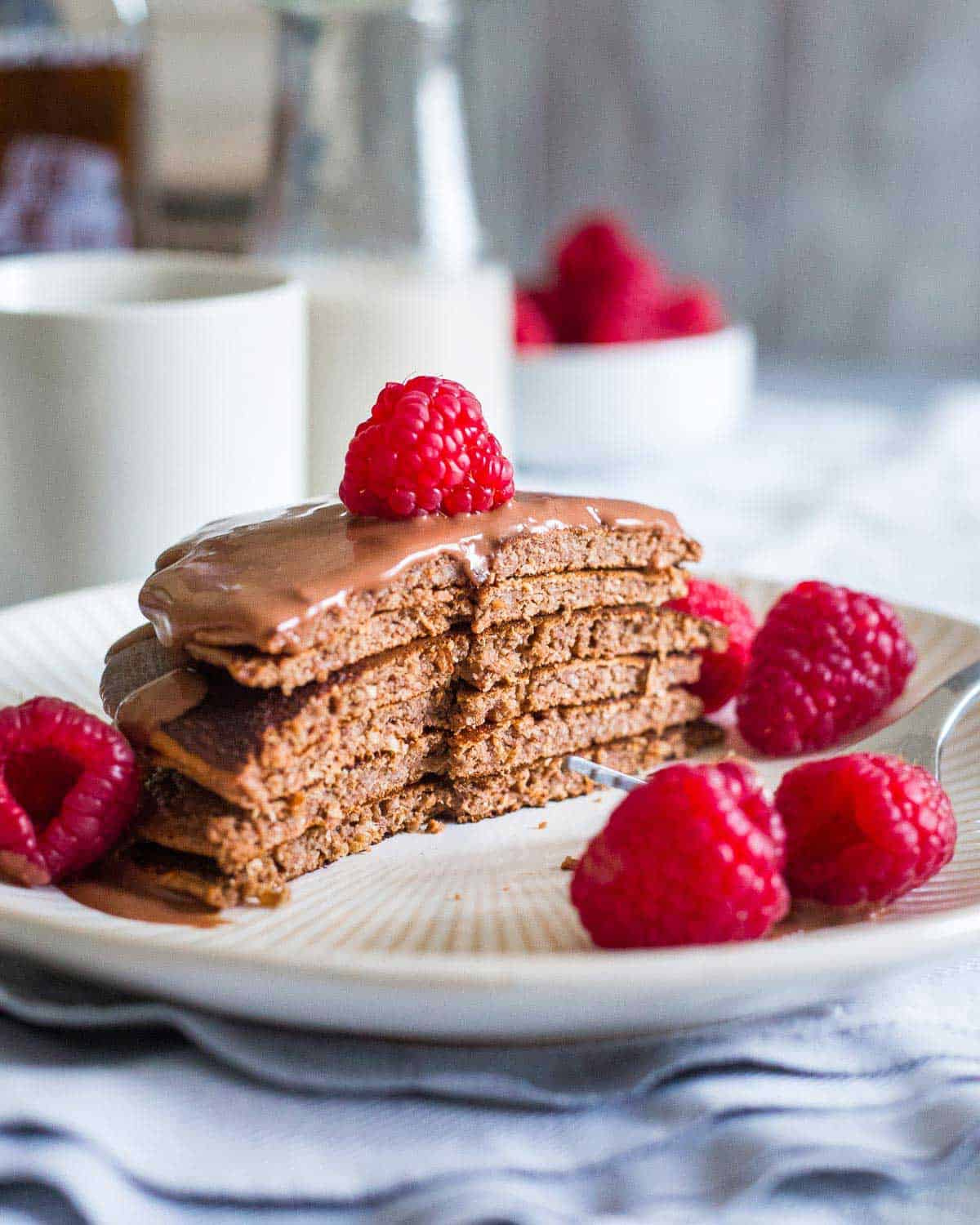 Full of chocolate flavor and with a delicious chocolate sauce on top, these protein pancakes taste more like dessert than a healthy breakfast!