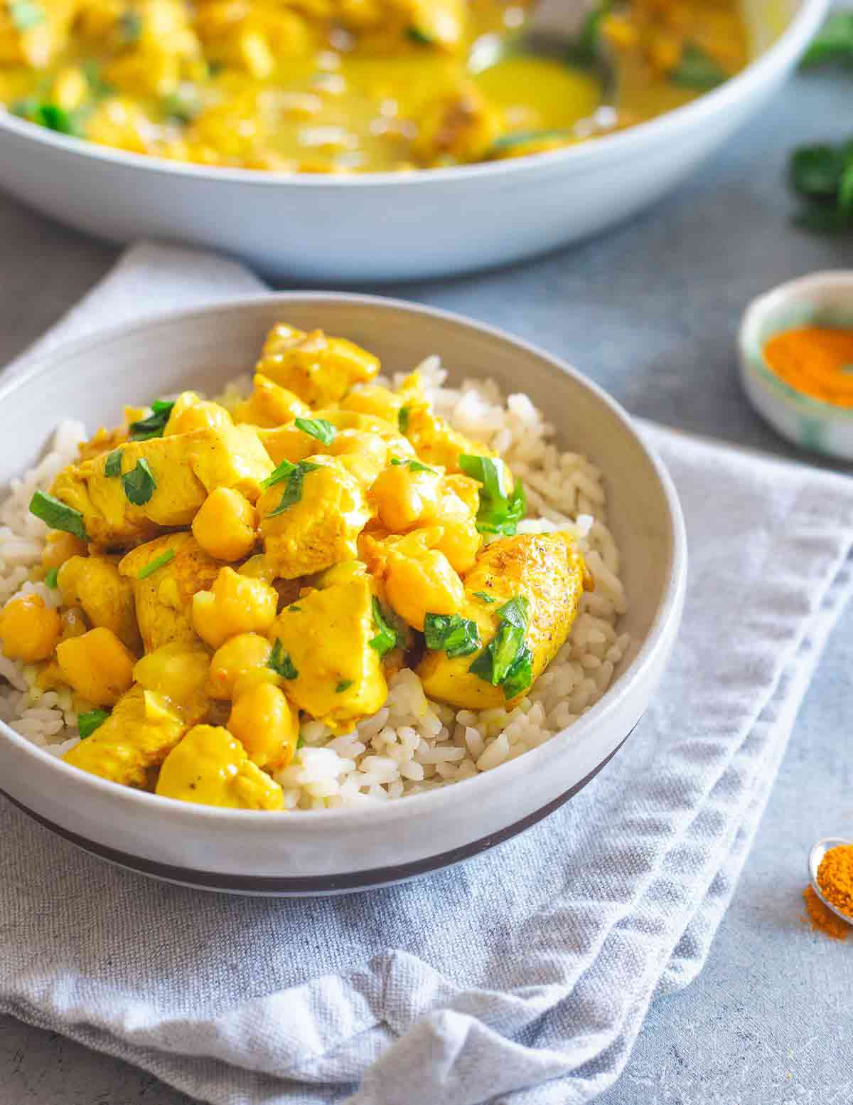 This creamy turmeric chicken is an easy one-skillet meal with hearty chickpeas. Serve it over rice with a cilantro garnish for a delicious dinner in under 30 minutes.