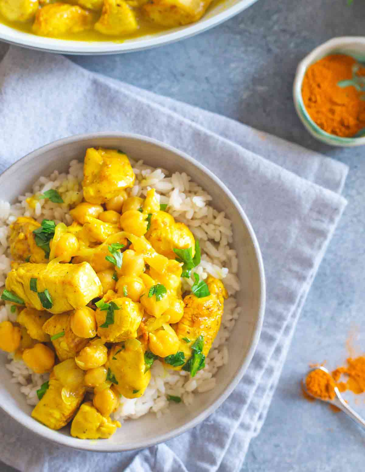 This turmeric chicken recipe is creamy and hearty with chickpeas and made in just 1 skillet in under 30 minutes.