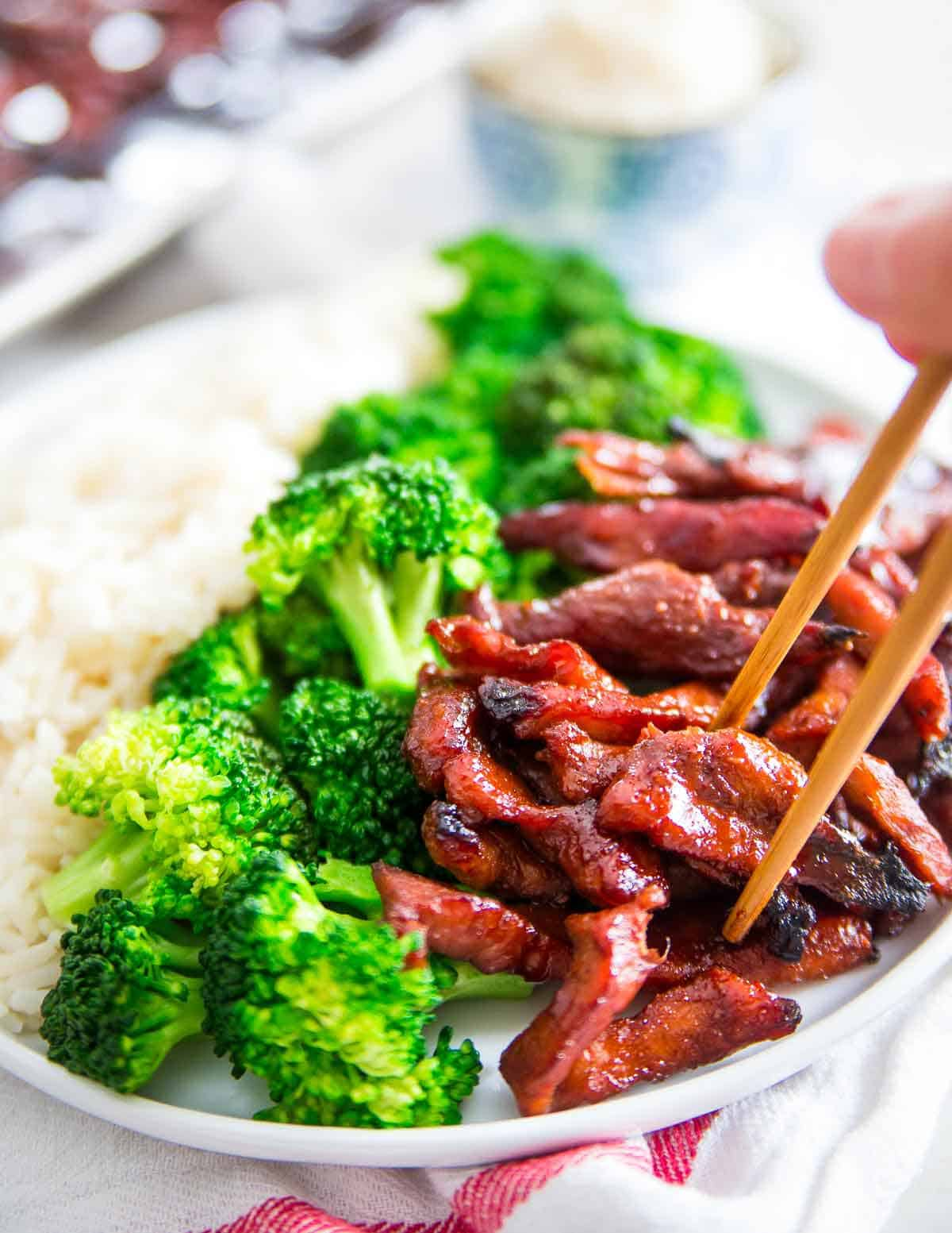 These Chinese boneless spare ribs are just like the takeout recipe. Sticky and sweet with crispy edges and that deep red color. Learn how easily you can make them at home!