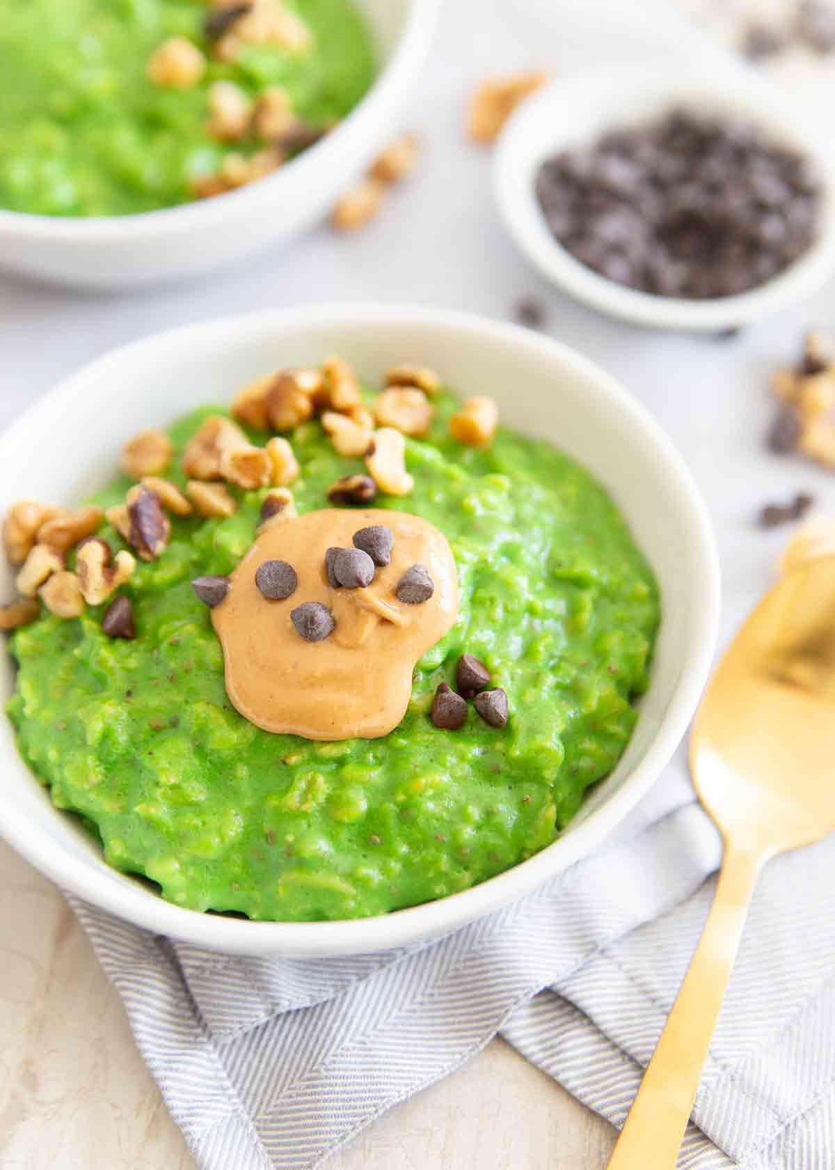 This green oatmeal is the perfect St. Patrick's Day breakfast recipe. Made with spinach, oats, bananas, milk it's a festive and healthy start to the day.