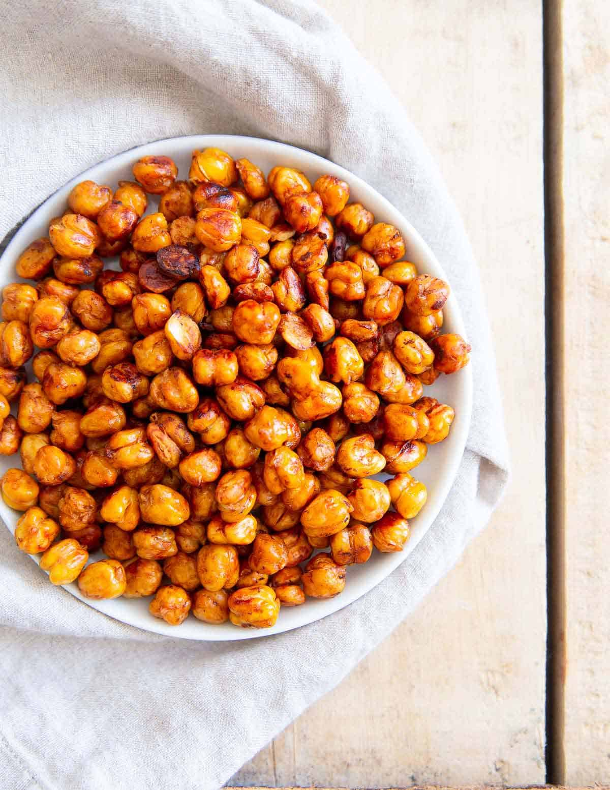 These easy, crispy, roasted BBQ chickpeas make a delicious option for healthy snacking or the perfect crunchy topper for salads.
