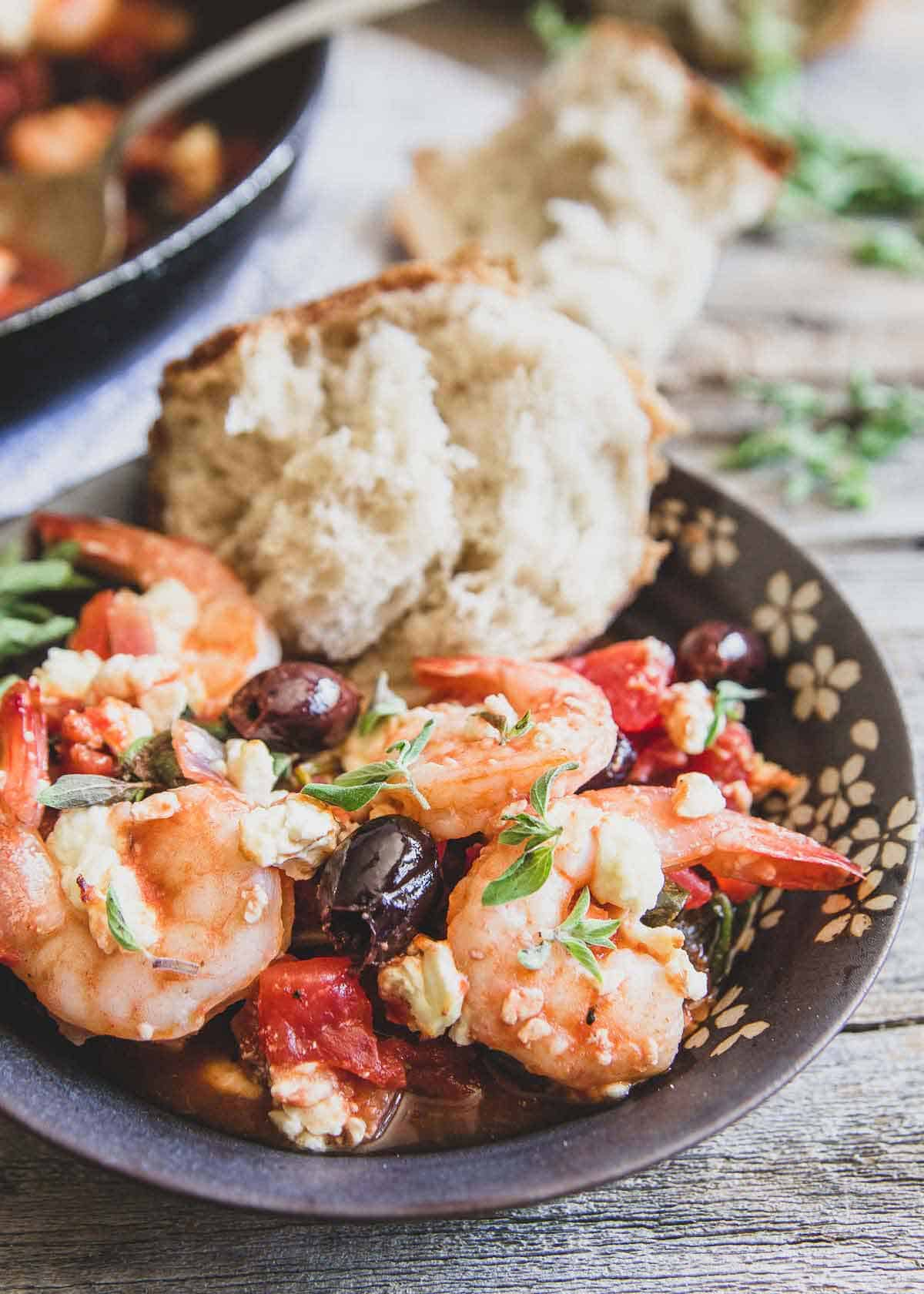 This easy Greek shrimp recipe is made entirely in the skillet with tomatoes, Kalamata olives, feta and lots of lemon and oregano.