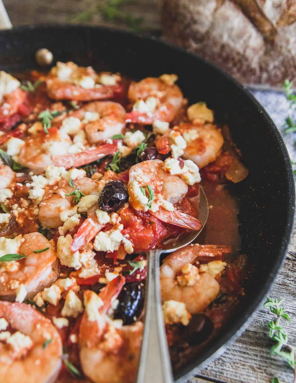 Greek shrimp made in the skillet is full of all the traditional Greek flavors you love and perfect served with some crusty bread or rice.