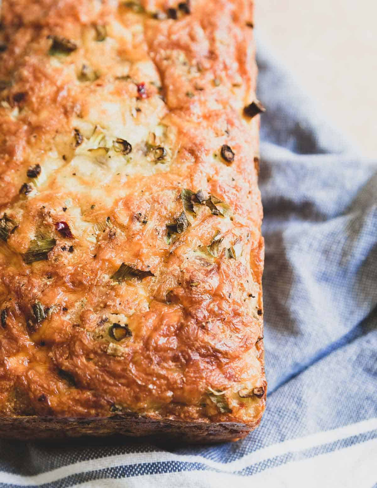 This cheesy zucchini bread is hearty, savory and filled with pepper jack cheese. The perfect way to use up fresh summer zucchini!