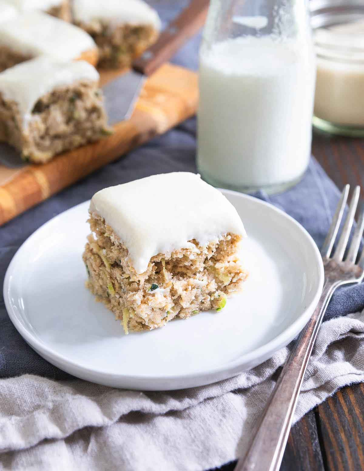 These zucchini bars use healthier, gluten-free ingredients, less sugar and less oil than the classic recipe with a better for you cream cheese icing too!