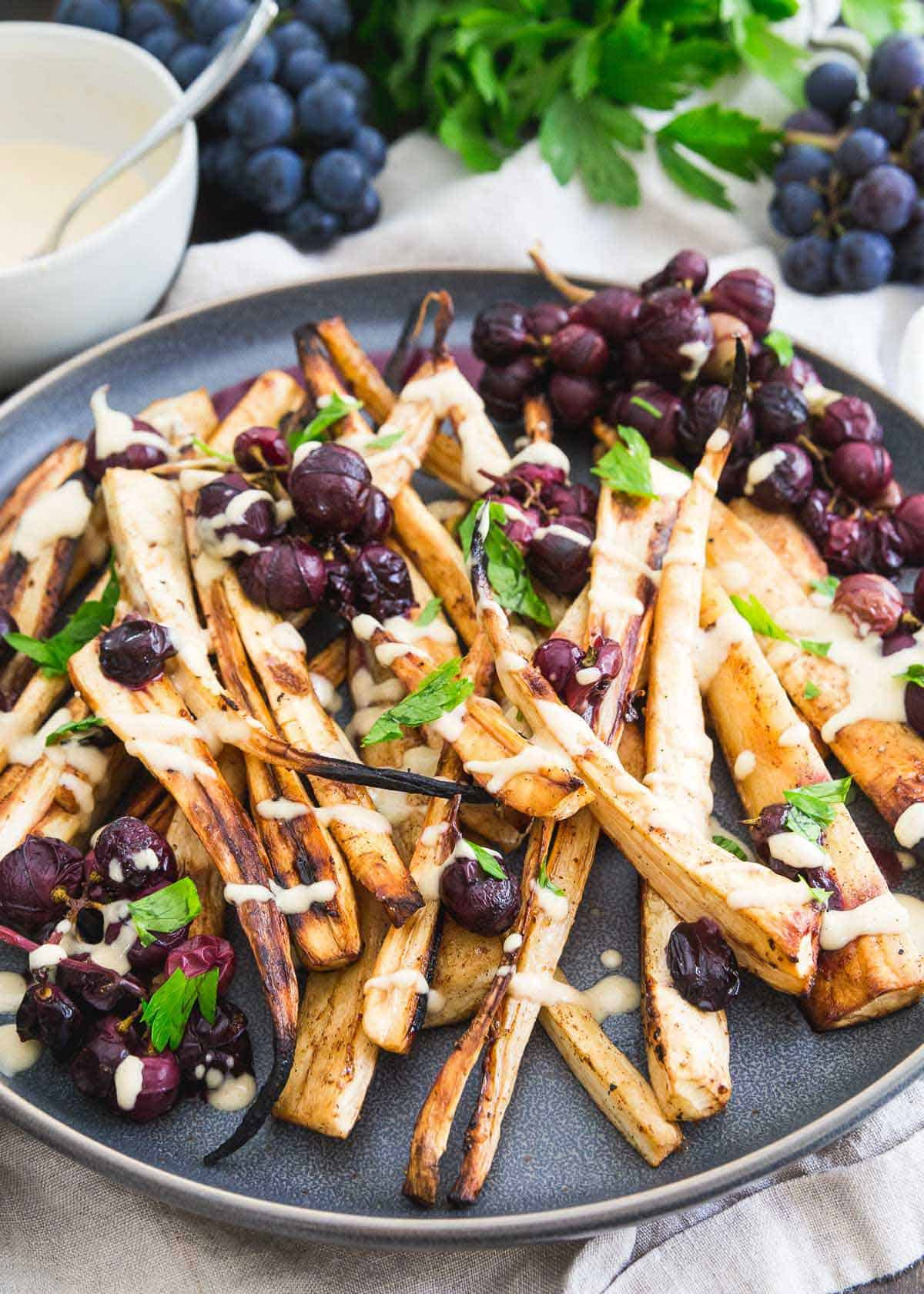 Roasted parsnips and concord grapes with cinnamon, brown sugar and a sweet hummus dressing.