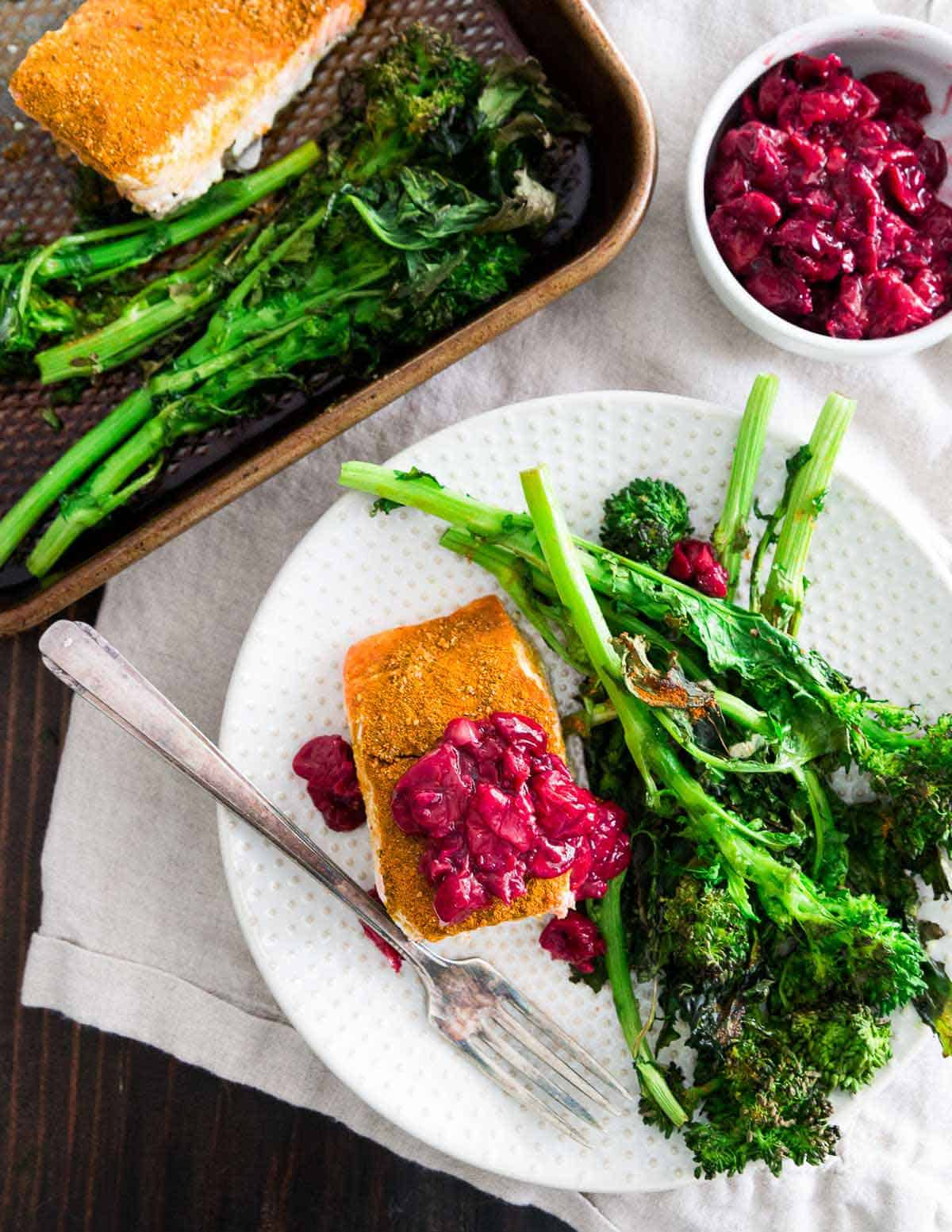 This sheet pan turmeric salmon with a quick garlic cherry sauce and roasted broccoli is a wholesome, healthy and anti-inflammatory dinner recipe that's super easy to put together.