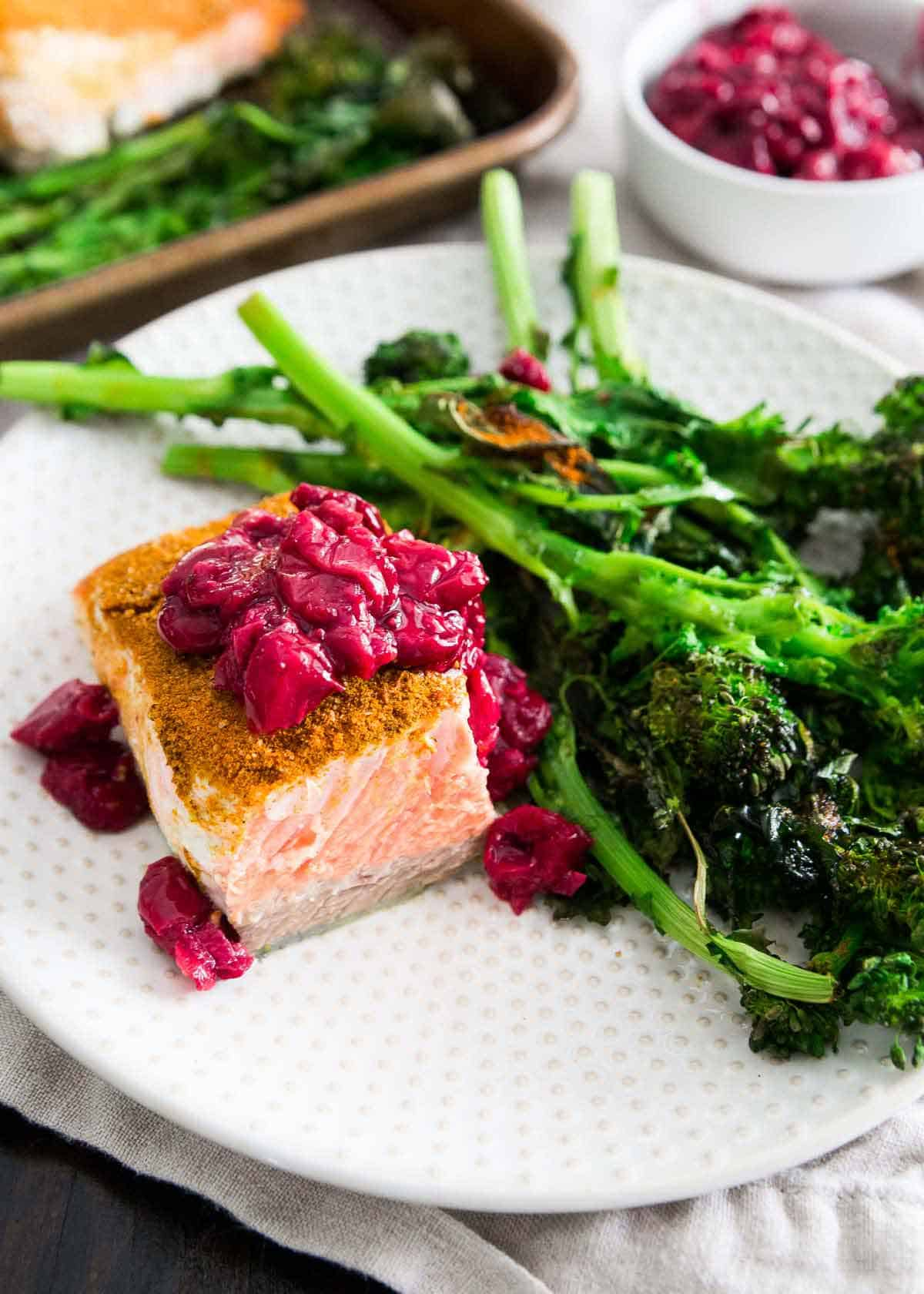 Serve this turmeric salmon and roasted broccoli rabe with a quick and easy tart cherry garlic sauce.