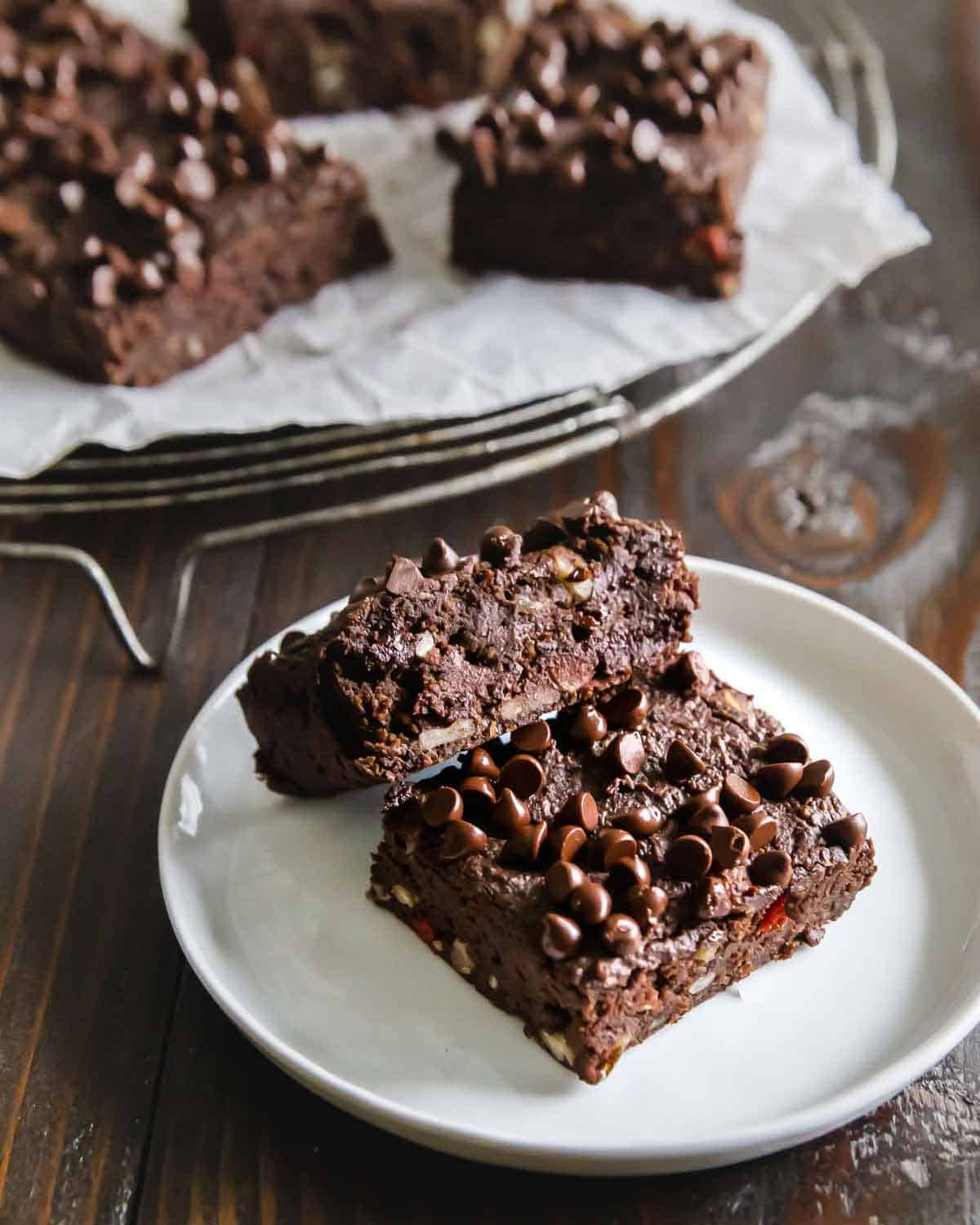 Intensely fudgy vegan brownies made with black beans require just 1 bowl and 20 minutes to bake for the ultimate healthy chocolate dessert.