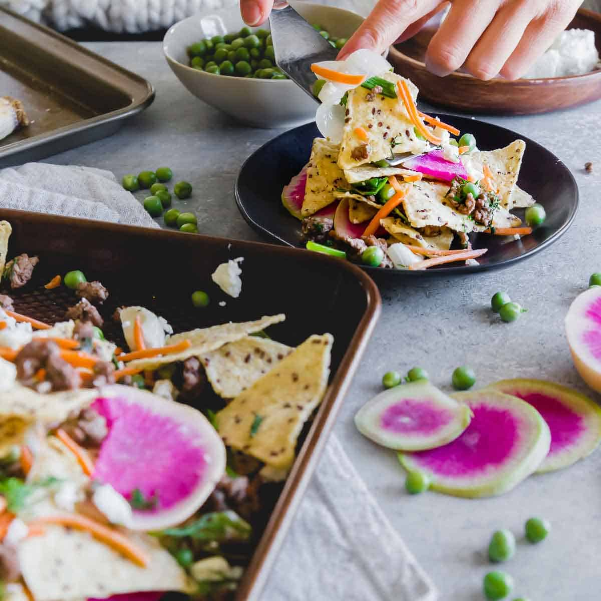 Celebrate spring with these lamb nachos and early spring vegetables on crispy corn tortillas with feta cheese.