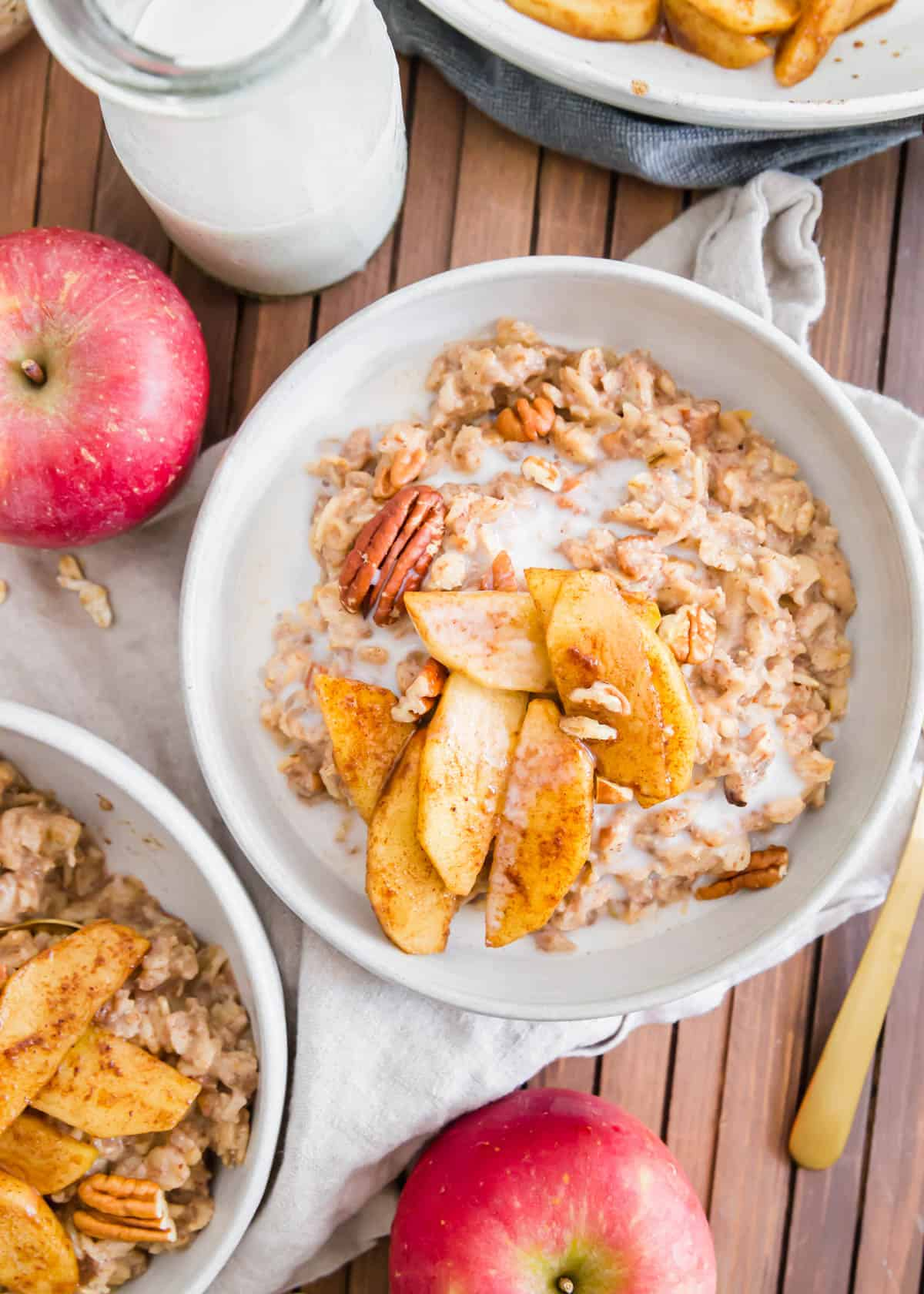 Apple cinnamon oatmeal is the perfect fall breakfast. It's packed with cooked apples and warming spices like cinnamon, nutmeg and ginger then topped with maple syrup sautéed apple slices and chopped pecans.