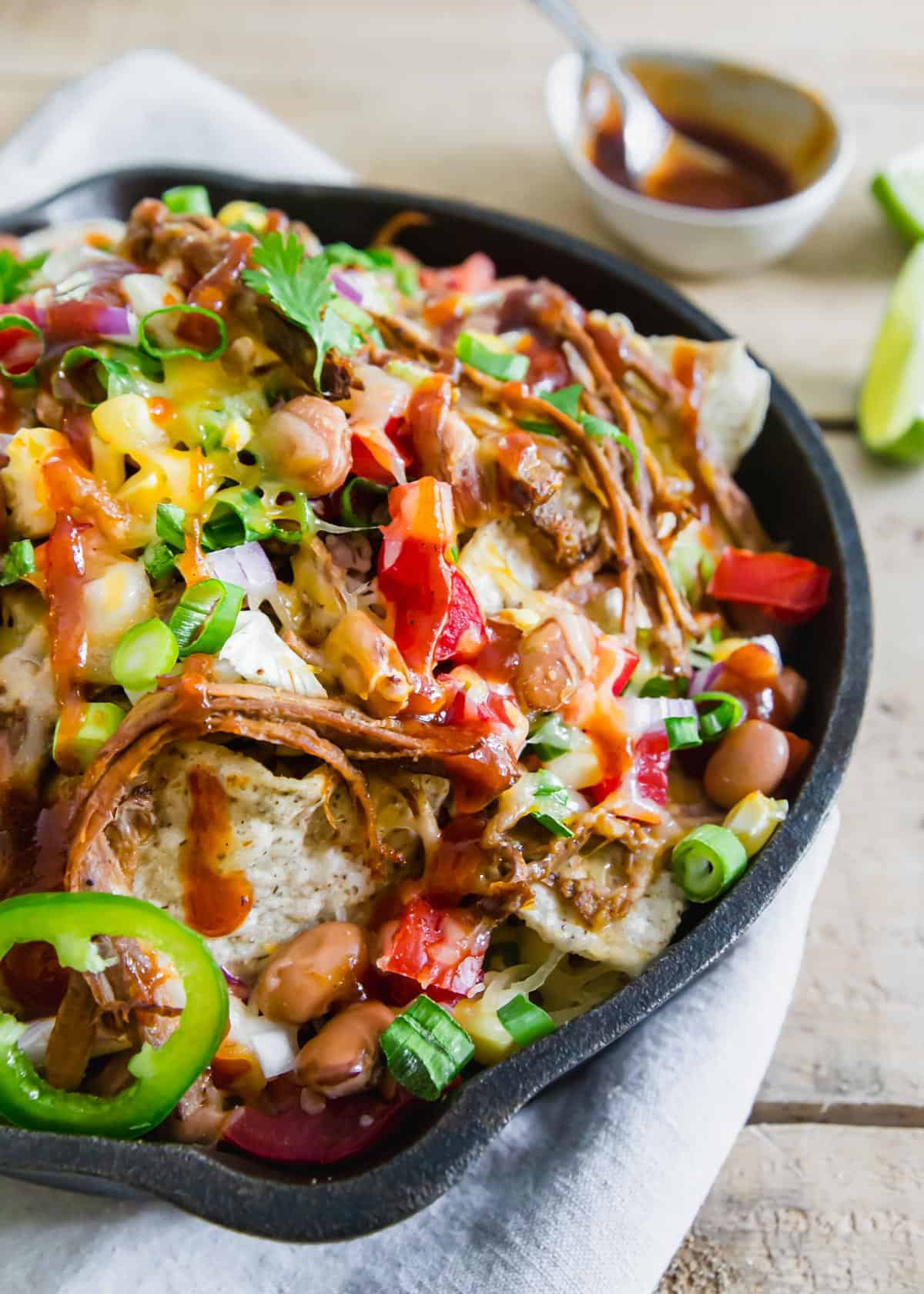 Use leftover shredded beef brisket to make these easy but insanely delicious BBQ brisket nachos. They're great as a party appetizer, dinner or addition to a game day spread and easy to customize to your topping preferences!