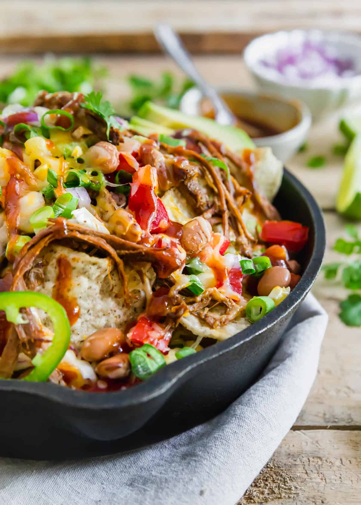 Grab some tortilla chips, some leftover brisket and your favorite toppings to create these easy brisket nachos.