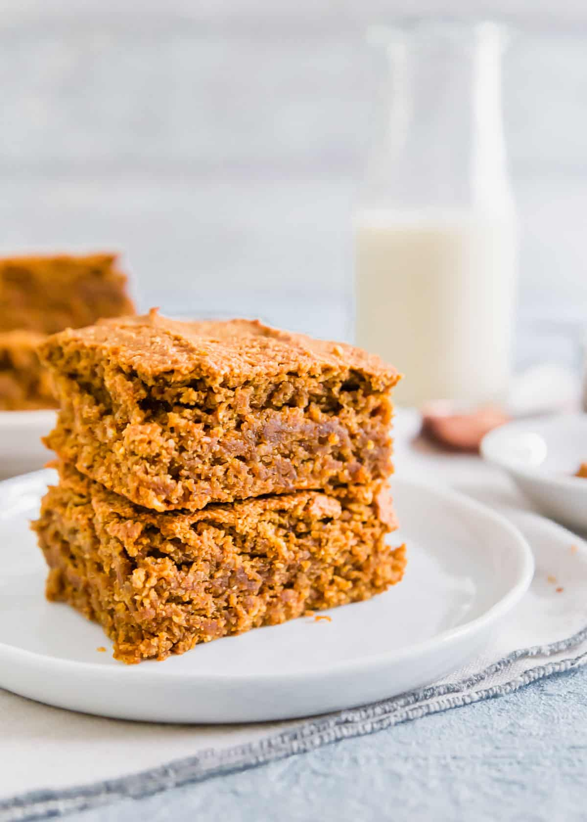Moist, cake-like pumpkin bars that are gluten-free and vegan! Packed with fall spices to make a delicious afternoon snack or dessert.