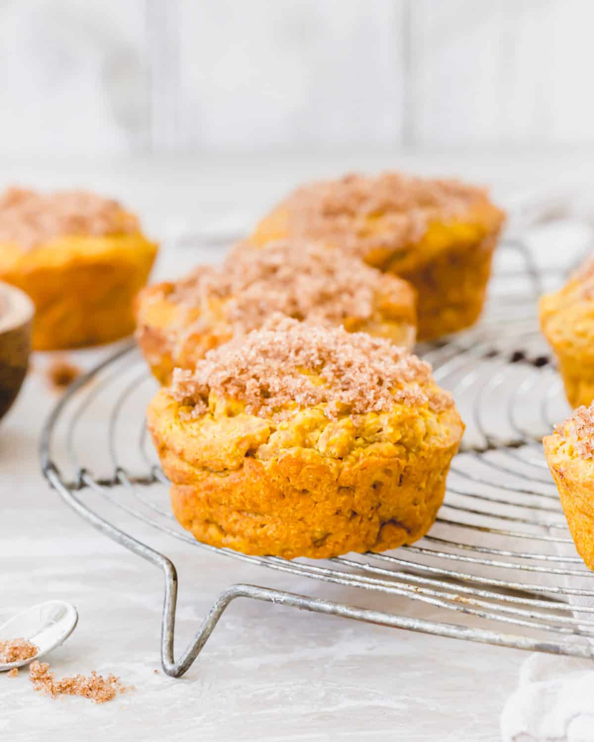 Gluten-free pumpkin muffins are an easy fall treat you'll love. They're made with simple ingredients like gluten-free & oat flours, warming pumpkin spices and topped with cinnamon sugar. They're dairy-free and vegan too!